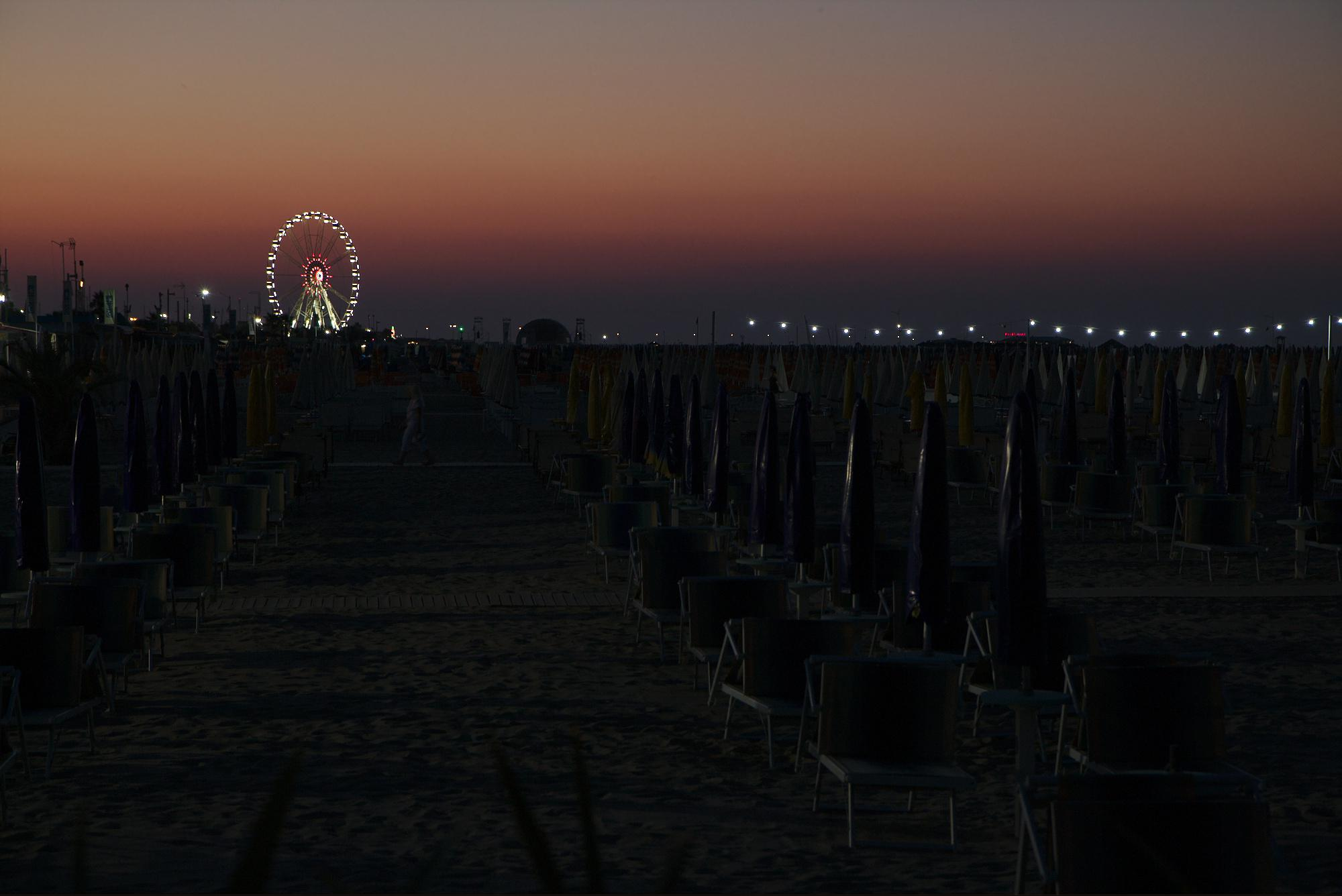 Rimini beach at night with the ferris wheel
