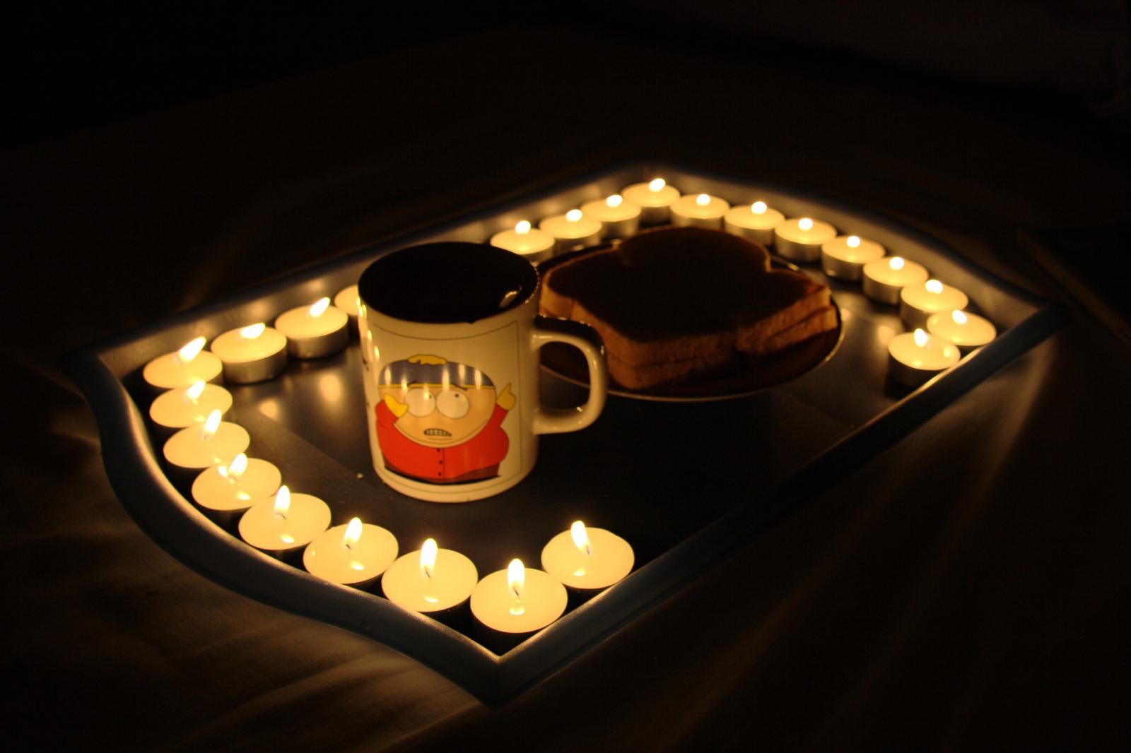 Breakfast on bed with candles